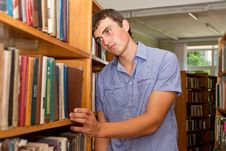 Free Depressed Student Standing At The Library Stock Photo - 25780340