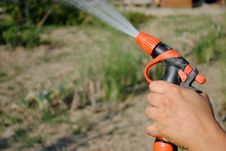 Free Hand With A Water Gun Stock Photo - 25783340