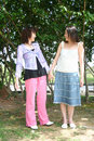 Free Girls Holding Hand In The Park Royalty Free Stock Photos - 2586468