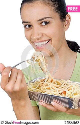 Free Girl Eating Spaghetti Stock Photos - 2586563