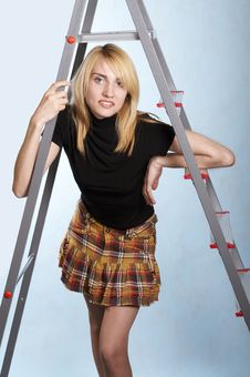 Woman Standing Under A Ladder Royalty Free Stock Images