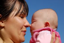 Mother Holding Newborn Baby Stock Image