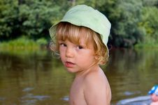Free Little Kid Stands Near River Royalty Free Stock Images - 2583089