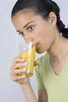 Free Girl Drinking Juice Royalty Free Stock Photography - 2586637