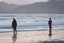 Two Men Fishing Stock Images