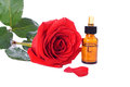 Free Bottles Of Essential Oil And Red Rose Stock Photos - 25803123