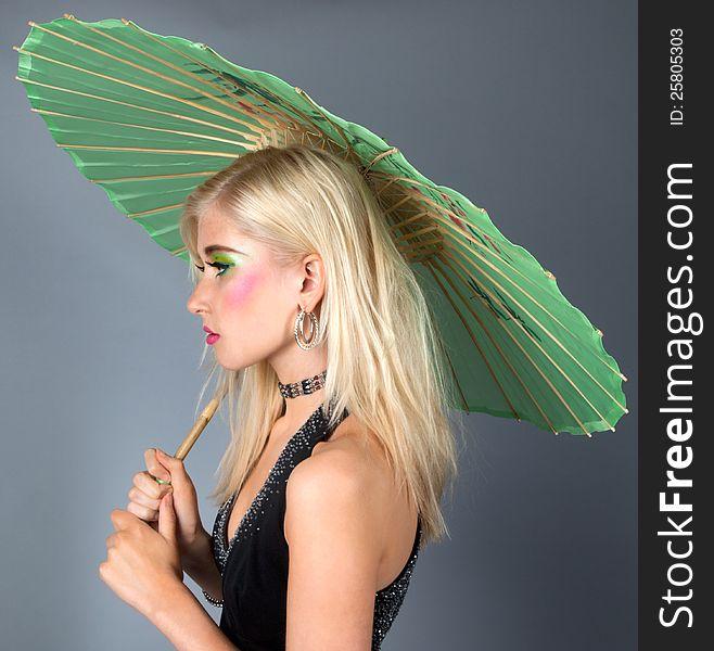 Teen In Fancy Makeup With Parasol