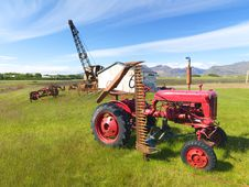 Free Picture Of A Tractor And Abandoned Machines Royalty Free Stock Photo - 25827115