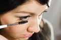 Free Beautiful Woman Applying Mascara On Her Eye Royalty Free Stock Photography - 25838297