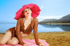 Free Girl On The Beach In A Red Hat Stock Photos - 25837103