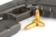 Free Bullets And Semi-automatic Gun Stock Images - 25838254