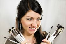 Beautiful Woman Holding Makeup Brushes Set Royalty Free Stock Photography