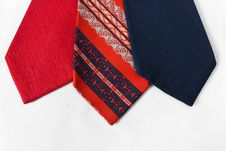 Free Neckties On White Cloth Royalty Free Stock Images - 25845879