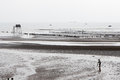 Free Worker At Beach During Low Tide Royalty Free Stock Photo - 25852985