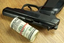 Free Dollars And A Gun Royalty Free Stock Photo - 25854795