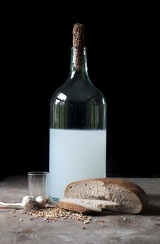 Old Bottle With Alcohol, Wheat, Corn, Glass And Ga Stock Images