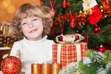 Happy Child With Gift Royalty Free Stock Photos