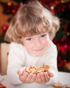 Free Happy Child Holding Cookies Stock Image - 25860661