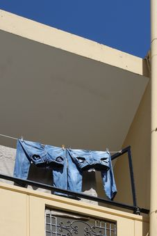 Two Jeans Drying On Balcony Stock Photos
