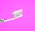 Free Toothbrush With Toothpaste On Pink Background Royalty Free Stock Images - 25892179