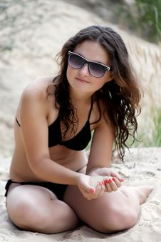 Free Girl With Glasses And Sand Stock Photography - 25891192