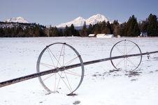 Free Irrigation Device Oregon Farm Wintertime Mountains Royalty Free Stock Photos - 25893948