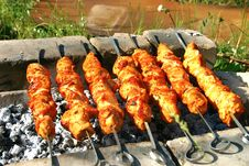 Meat Grilled On Metallic Skewers Over A Fire Stock Photography