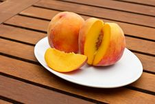 Free Two Fresh Peaches On While Oval Plate Royalty Free Stock Image - 25898776