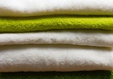 Free Pile Of Clean White And Green Towels Royalty Free Stock Photography - 25898877