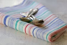 Set Of Silver Teaspoons On The  Kitchen Towel Royalty Free Stock Images