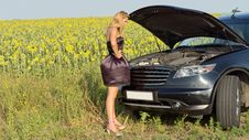 Free Bemused Woman Looking At Car Engine Stock Photography - 25899762