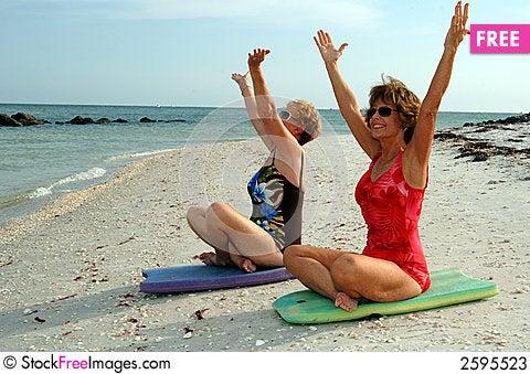 Women meditation on beach Stock Photo