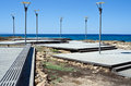 Free Road To The Sea And Lampposts Royalty Free Stock Photography - 25904767