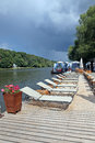 Free Lounge Chairs On A Wooden Pier Royalty Free Stock Photos - 25907288