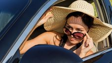 Free Female Driver Checking Her Side Mirror Royalty Free Stock Photo - 25900035