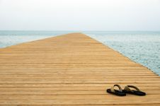 Free Thongs On Pier Royalty Free Stock Photography - 25900077