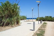 Road To The Sea And Lampposts Royalty Free Stock Photography