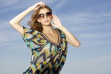 Free Beautiful Girl In Sunglasses On Blue Sky Stock Images - 25913104