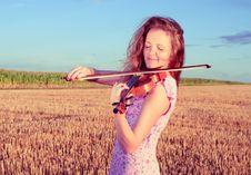 Free Redhead Woman Playing Violin Stock Photo - 25914780