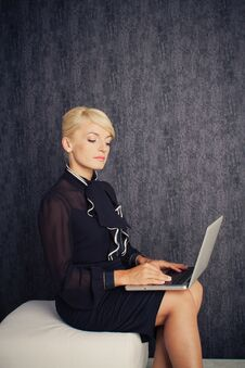 Free Blonde Business Woman Sitting With Notebook Stock Image - 25920741