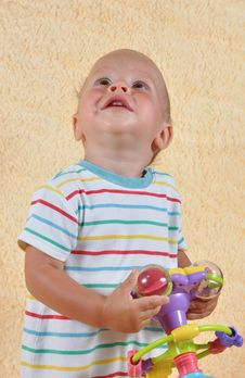 Free The Child With A Toy Royalty Free Stock Image - 25927846