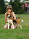 Free Girl With Her Beagle. Royalty Free Stock Photo - 25946165