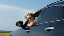 Free Woman Looking Out Of Car Window Royalty Free Stock Photography - 25944377