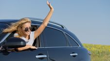 Free Woman Waving From Car Window Stock Image - 25944391