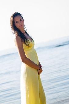 Free Yellow Dress Brunette Beach Stock Image - 25945391