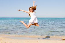 Free Happy Young Woman Jumping On The Beach Stock Photography - 25948892