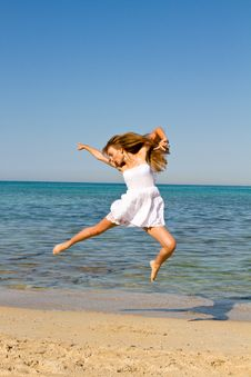 Free Young  Woman Jumping On The Beach Royalty Free Stock Photos - 25948968