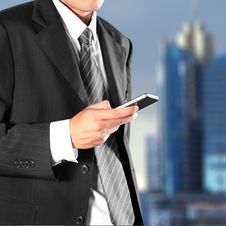 Free Businessman Holding The Phone Stock Photos - 25949303