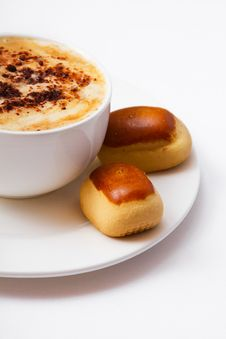 Cup Of Coffee And Sweets On The Saucer Stock Photos