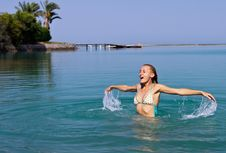 Free Happy Young Woman Playing In The Sea Royalty Free Stock Images - 25970319